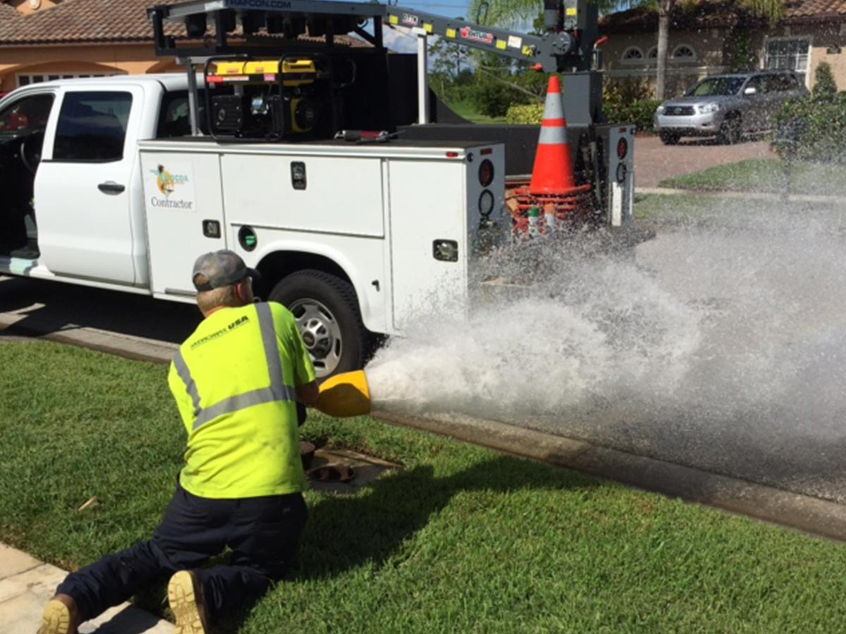 A HydroMax USA worker venting a hydrant during an assessment.