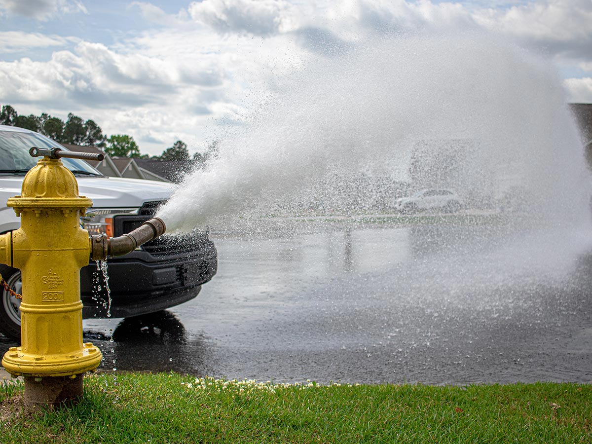 A hydrant being flushed during an assessment.